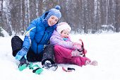 stock photo of luge  - Happy Mother And Daughter - JPG