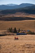 stock photo of beartooth  - Three young boys heading down a pasture on a deer hunting trip in Montana - JPG