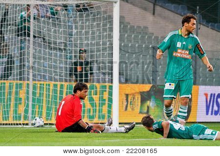 VIENNA,  AUSTRIA - JULY 26: Diego Alves Carreira (No. 1, Valencia) sits on the ground after the third goal during the friendly soccer game on July 26, 2011 in Vienna, Austria. SK Rapid wins 4:1.
