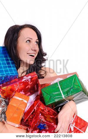 pretty young woman in red christmas clothing with a lot of present boxes, isolated on white