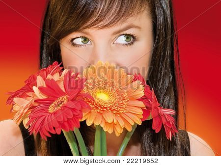 woman with dark hair hiding behind flowers