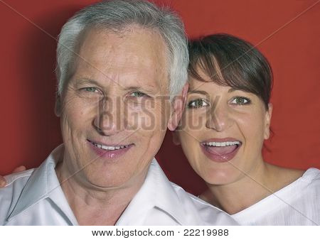 father and daughter laughing