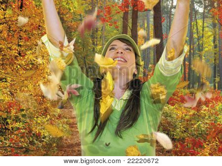 happy girl is throwing leaves