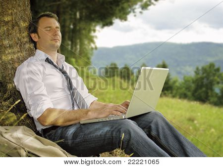 businessman is working and relaxing in the nature. Unique keyword for this collection is: naturebusiness77