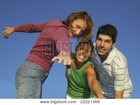 Three friends fooling around on a summerday. keyword for this collection is family7