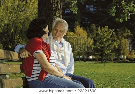 attractive married mature couple relaxing in the park. keyword for this collection is