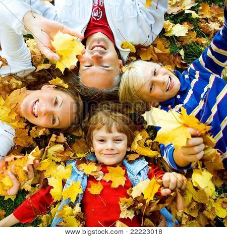 cute family in  a park on an autumn-day
