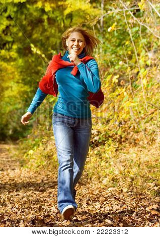 girl taking a walk in an autumn-forest