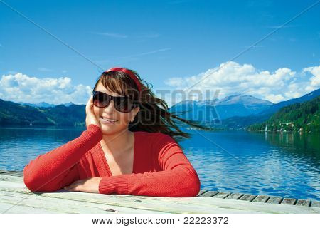 happy girl in front of a lake