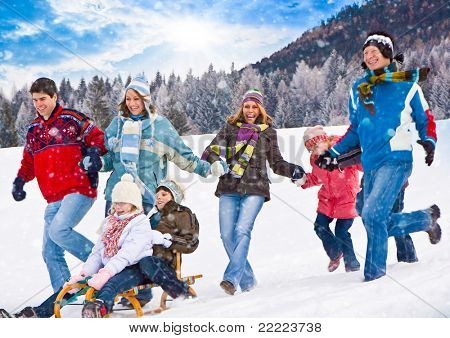 cute family having fun in the snow