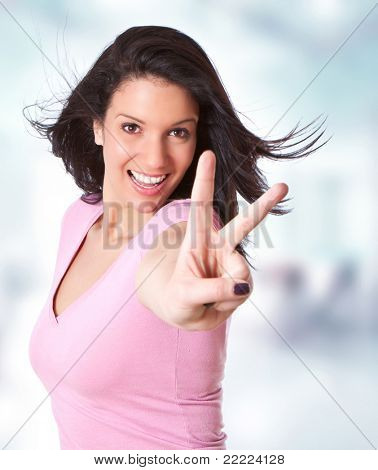 beautiful young girl making a victory sign