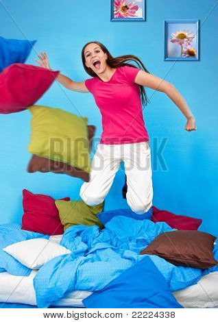 young teenage-woman is in a pillow-fight (my flower photos)