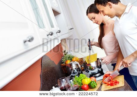 Portrait of amorous couple cooking spaghetti in the kitchen
