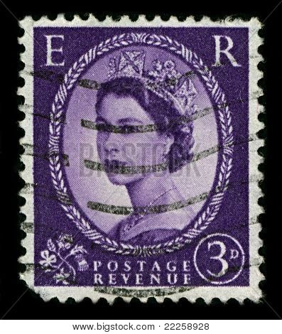 ENGLAND-CIRCA 1952:A stamp printed in ENGLAND shows image of Elizabeth II (Elizabeth Alexandra Mary, born 21 April 1926) is the constitutional monarch of United Kingdom in blue, circa 1952.