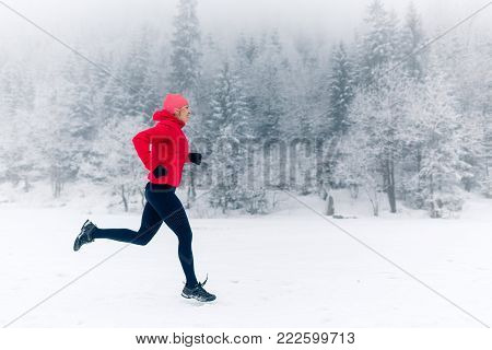 Trail Running Woman In Winter