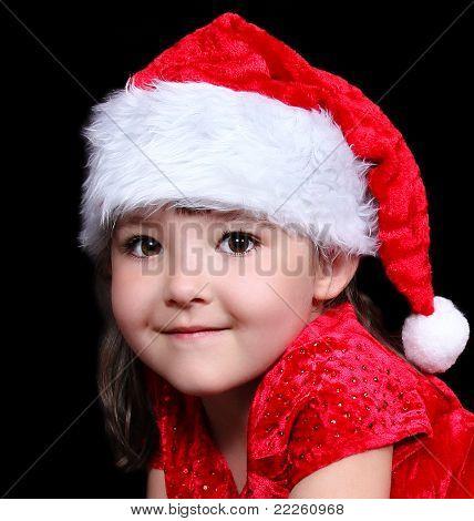 Nahaufnahme der schönen Mädchen In Nikolausmütze isoliert auf schwarz