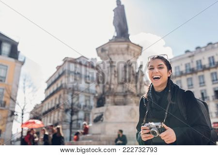 poster of Female traveler woman walking streets of European capital.Visitor in Lisbon,Portugal.Traveling Europe on a budget.Studying abroad.Student discount for traveling concept