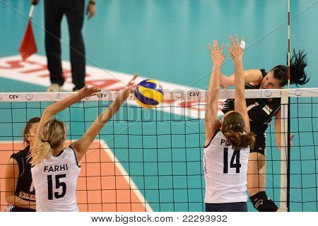 DEBRECEN, HUNGARY - JULY 9: Rita Liliom (in black 1) in action a CEV European League woman's volleyball game Hungary (black) vs Israel (white) on July 9, 2011 in Debrecen, Hungary.