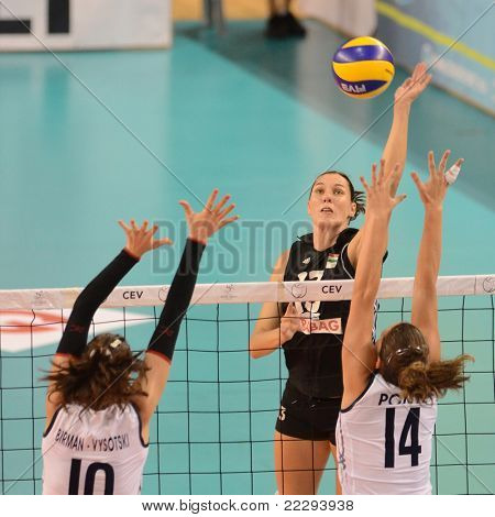 DEBRECEN, HUNGARY - JULY 9: Katalin Kiss (in black 13) in action a CEV European League woman's volleyball game Hungary (black) vs Israel (white) on July 9, 2011 in Debrecen, Hungary.