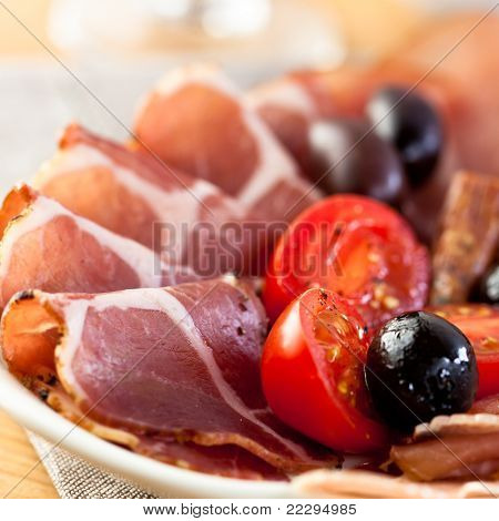 Coppa with olives and cherry tomatoes