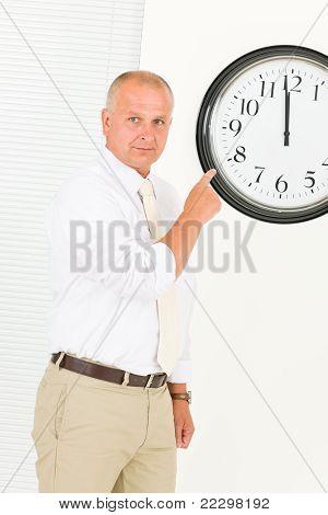 Punctual Businessman Mature Point At Clock
