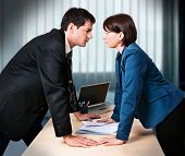 foto of envy  - businesswoman and businessman are fighting - JPG
