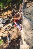 Girl Climber On A Rock. poster