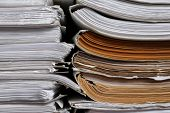 Stacks of old paper documents in archive, closeup poster
