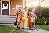 Children Wearing Halloween Costumes For Trick Or Treating poster