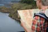 Traveler Man With Map, Backpack Travel At Forest & Lake In Summer. Tourist Backpacker Relaxing Outdo poster