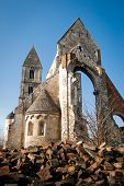 pic of rip-rap  - Ruins of the gothic Church of Zs�mb�k against blue sky