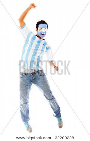 Happy Argentinean man celebrating with arms up - isolated over a white backgorund
