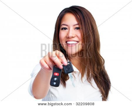 Asian woman with car key. Isolated on white background.