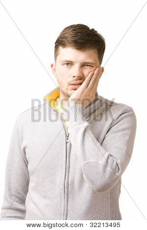 Young man suffering from toothache