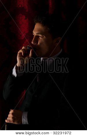 Profile Of Man Smoking In Night