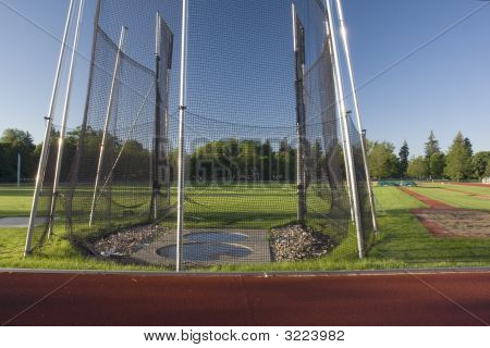 Athletic Field With A Hammer Throw Cage And Long Jump Sand Pit