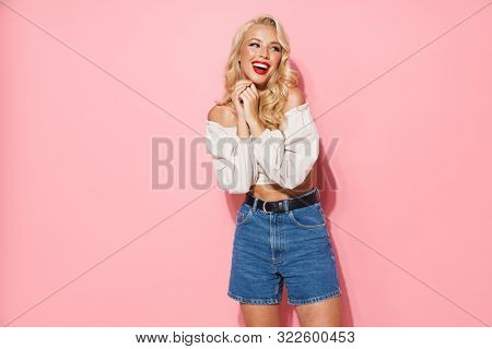 poster of Image of charming blonde woman with long curly hair wearing trendy clothes smiling and posing at cam