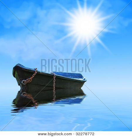 Abandoned rowboat and sunny sky