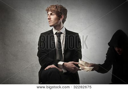 Corrupted young businessman accepting some money from a crook