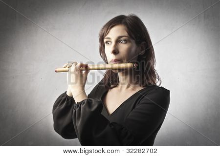 Young woman playing the flute