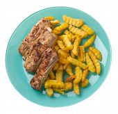 Grilled Pork Ribs With French Fries On A Turquoie Plate. Pork Ribs With French Fries On A White Back poster