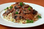 stock photo of marsala  - Chicken Marsala served on a bed of rice and orzo.