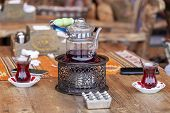 Turkish Tea In Traditional Glasses On Table. Traditional Turkish Tea Set: Glass Cup Of Tea, Painted  poster