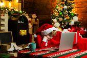 Gifts Service. Little Genius. Santa Little Helper. Little Boy Santa Hat And Costume Having Fun. Boy  poster