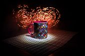 Beautiful Eastern Style Textured Ceramic Cup Of Coffee (or Tea) With Smoke Over Dark Toned Backgroun poster