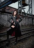 Fashion Shot: Portrait Of A Sexy Cute Goth Girl (informal Model) In Leather Coat, Stockings And Ling poster