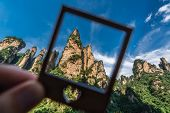 The Gathering Of Heavenly Soldiers Scenic Rock Formations In A Frame, Avatar Mountains Nature Park,  poster
