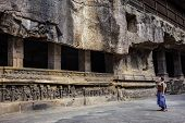 Girl Tourist Examines The Temple, Being In The Courtyard Kailash Temple In Ellora. Standalone, Multi poster