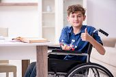 Disabled kid preparing for school at home poster