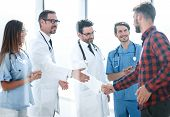 doctors congratulating the patient on recovery poster